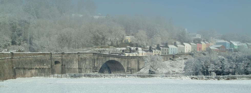 Llandeilo town and bridge emerging from mist after overnight snow